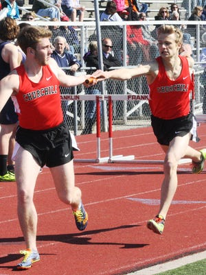 Dash Dobar hands the baton to Matt Cohan during Churchill's first-place showing in the 3,200-meter relay.
