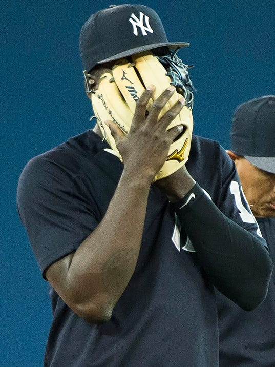 New York Yankees shortstop Didi Gregorius covers his face as he takes part in batting practice, Wednesday, March 28, 2018, ahead of the season opener against the Toronto Blue Jays in Toronto on Thursday. (Nathan Denette/The Canadian Press via AP)