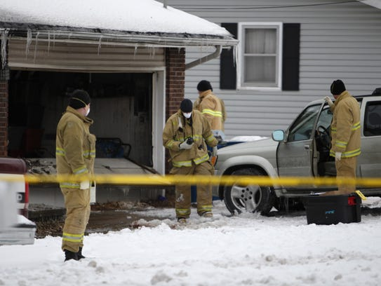 Officials say three bodies were found inside a burning
