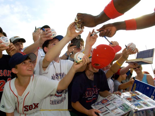 Young Red Sox fans crowd around Hanley Ramirez trying to get autographs after practice in 2005. Even more will be crowding around him on that date in 2015.