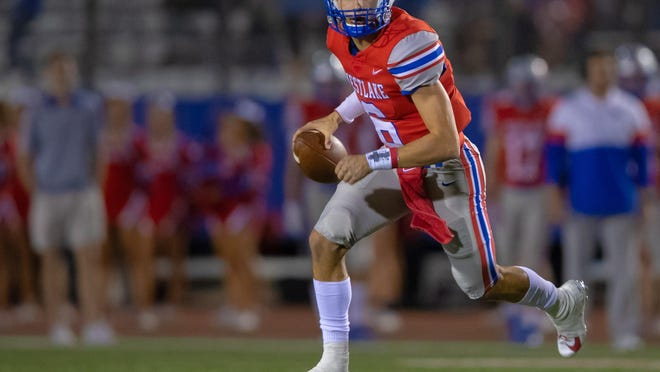 Westlake quarterback Cade Klubnik scampers downfield as he hunts for a receiver against Del Valle last year. Klubnik rotated with two other QBs early last season; this year he will be the unquestioned starter.