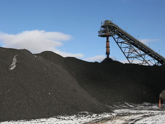 A conveyor belt brings coal from a nearby mine to PacifiCorp's Jim Bridger coal plant in southwestern Wyoming on Dec. 7, 2016.