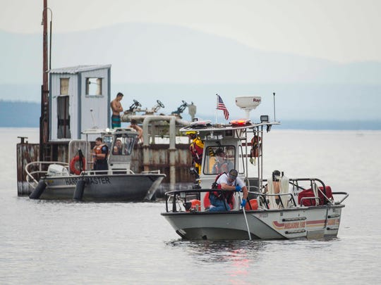 Searchers look for a person who disappeared after diving into Lake Champlain off Oakledge Park in Burlington on Monday, July 10, 2017.