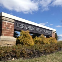 In a federal complaint, a mother of biracial children cites nine incidents in which she says she complained to school officials this past school year about racial slurs and threats directed at her children in Lebanon High and Junior High schools.