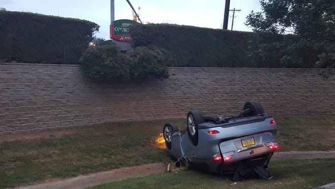 A vehicle went off a retaining wall and dropped 12 feet into a retention basin following a  South Brunswick crash.