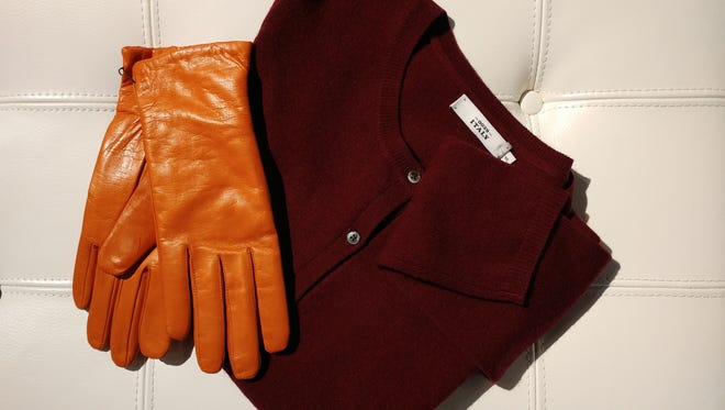 Cashmere lined gloves and cardigan by Hestra at THEO.