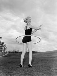 Model Fay Shott spins a Hula Hoop around her waist in Denver, Colorado, on Aug. 24, 1958.