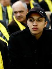 In this Feb. 16, 2009, file photo, Fayez, left, father of Imad Mughniyeh, and Jihad, the son of slain top Hezbollah's commander Imad Mughniyeh, attend a rally commemorating the first anniversary of Imad Mughniyeh's assassination in the southern suburb of Beirut, Lebanon. A Hezbollah official said Sunday, Jan. 18, 2015, that an Israeli strike in the Syrian Golan Heights killed Jihad Mughniyeh and four other fighters from the Lebanese Shiite militant group.