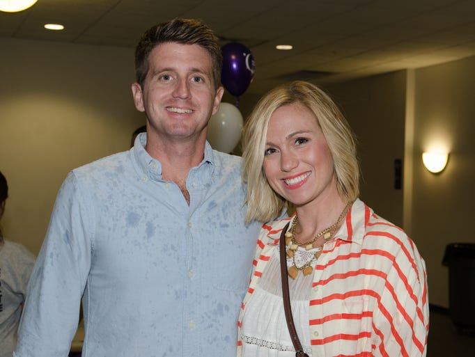 Nina and Jeff Lloyd were some of many who braved rainy weather to support Stand Up 2 Cancer, a charity event Sept. 5 in Cocoa.