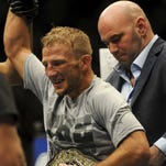New bantamweight champion TJ Dillashaw celebrates his TKO win over opponent Renan Barao (not pictured) following their UFC 173 bantamweight championship bout at MGM Grand Garden Arena.