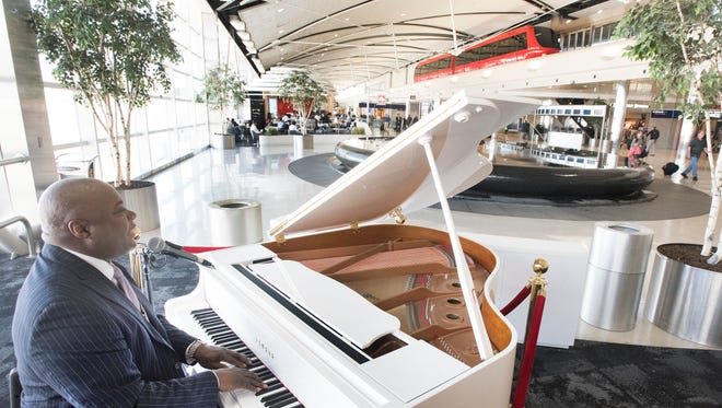 Musician Keith Ferguson plays at Detroit Metro Airport in 2016. The survey measures overall traveler satisfaction with terminal facilities, airport accessibility, security check, baggage claim, baggage checkand retail at mega, large and medium North American airports.