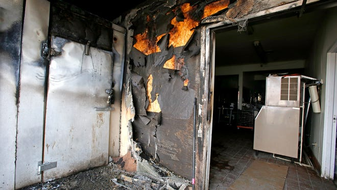 The walk-in freezer displays burn marks on Thursday at the Roadside Restaurant in Bloomfield.