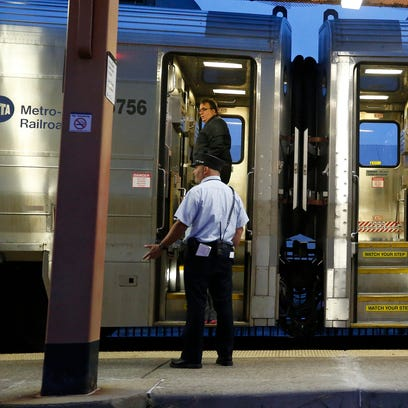 A conductor explains the schedule to a commuter at