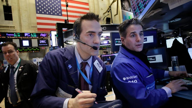 Traders at the New York Stock Exchange on Feb. 12.