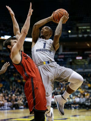 Marquette's Duane Wilson shoots over SIU-Edwardsville's Burak Eslik during the first half of Wednesday's 89-56 win at the BMO Harris Bradley Center.