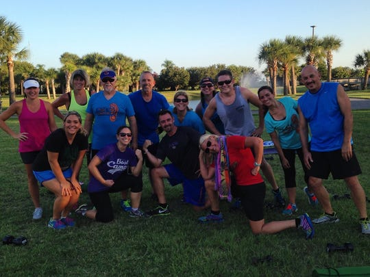The evening boot camp crew from Brevard's Premier Personal Training and Boot Camp, post workout, at Manatee Sanctuary Park in Cape Canaveral.