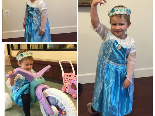 Alanya wears an Elsa dress after radiation.