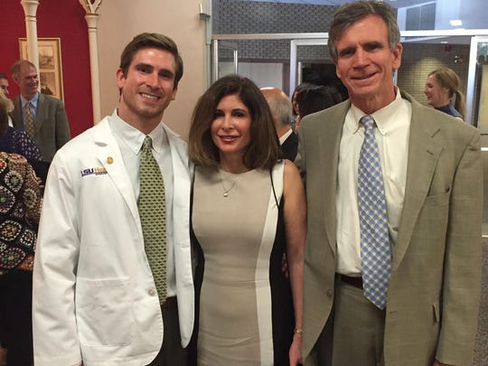 Clifton and parents Drs. Lori and Richard Byrd at White