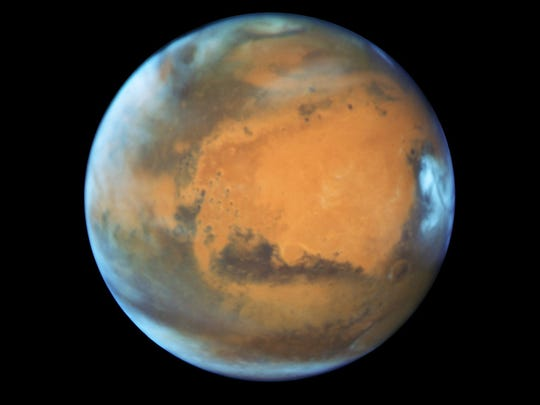 Mars covered in clouds viewed by the Hubble Space Telescope,