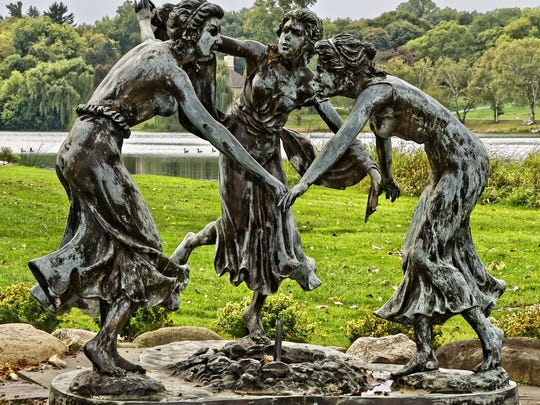 The three bronze dancing young women represent Rose