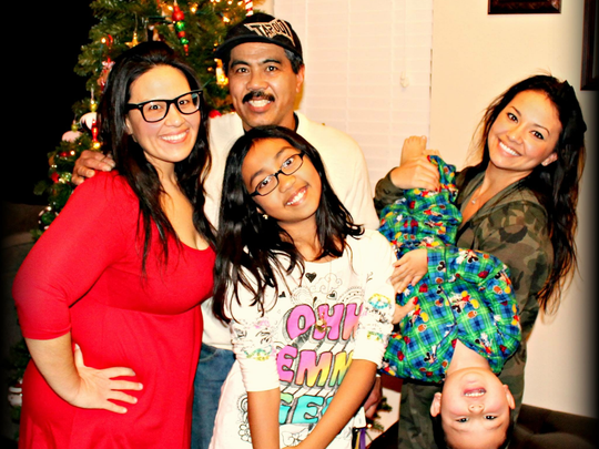 Michael Mendoza (back center) with several members of his family.