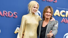Nicole Kidman, left, and Keith Urban on the red carpet
