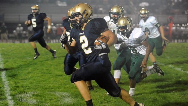 Lancaster's Shea Goss runs the ball down the field during Lancaster's game against Dublin Jerome Friday, Sept. 4, 2015, at Fulton Field. The Gales defeated the Celtics 33-0.