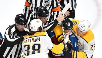 Nashville Predators right wing Ryan Hartman (38) punches Colorado Avalanche right wing Sven Andrighetto (10) as Nashville Predators defenseman Alexei Emelin (25) hangs on during the second period of game 4 in the first round NHL Stanley Cup Playoffs at the Pepsi Center, Wednesday, April 18, 2018, in Denver, Colo.