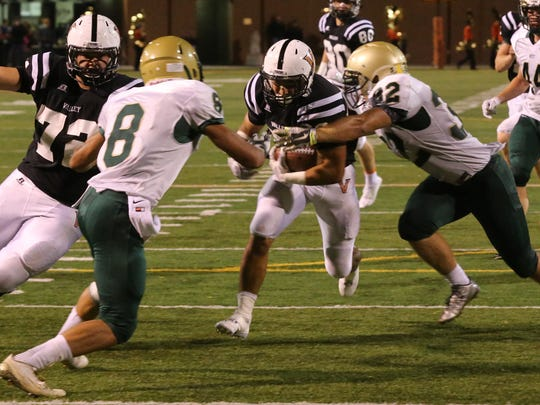 Valley's Drew Gray runs the ball for a touchdown past