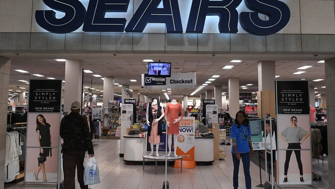 """Customers enter a Sears store at a mall in California on March 22, 2017.  Sears, considered the iconic American department store, saw its stock prices plunge March 22 after its parent company said there was """"substantial doubt"""" about the retailer's ability to stay in business."""
