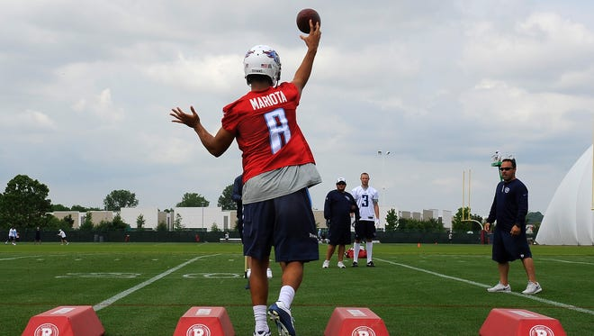 Titans quarterback Marcus Mariota (8) throws a pass during quarterback drills  at St. Thomas Sports Park on Friday.