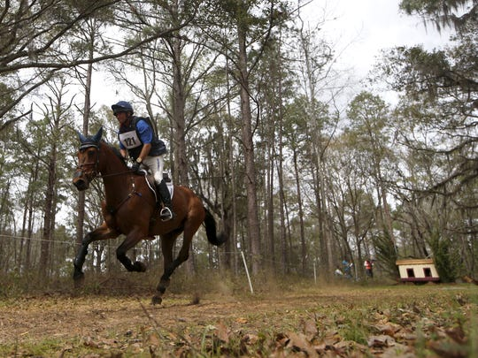 Phillip Dutton rides Z on the cross country race during the Red Hills Horse Trials on Saturday, March 12, 2016.