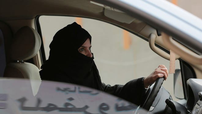 In this Saturday, March 29, 2014, file photo, Aziza Yousef drives a car on a highway in Riyadh, Saudi Arabia as part of a campaign to defy Saudi Arabia's ban on women driving.