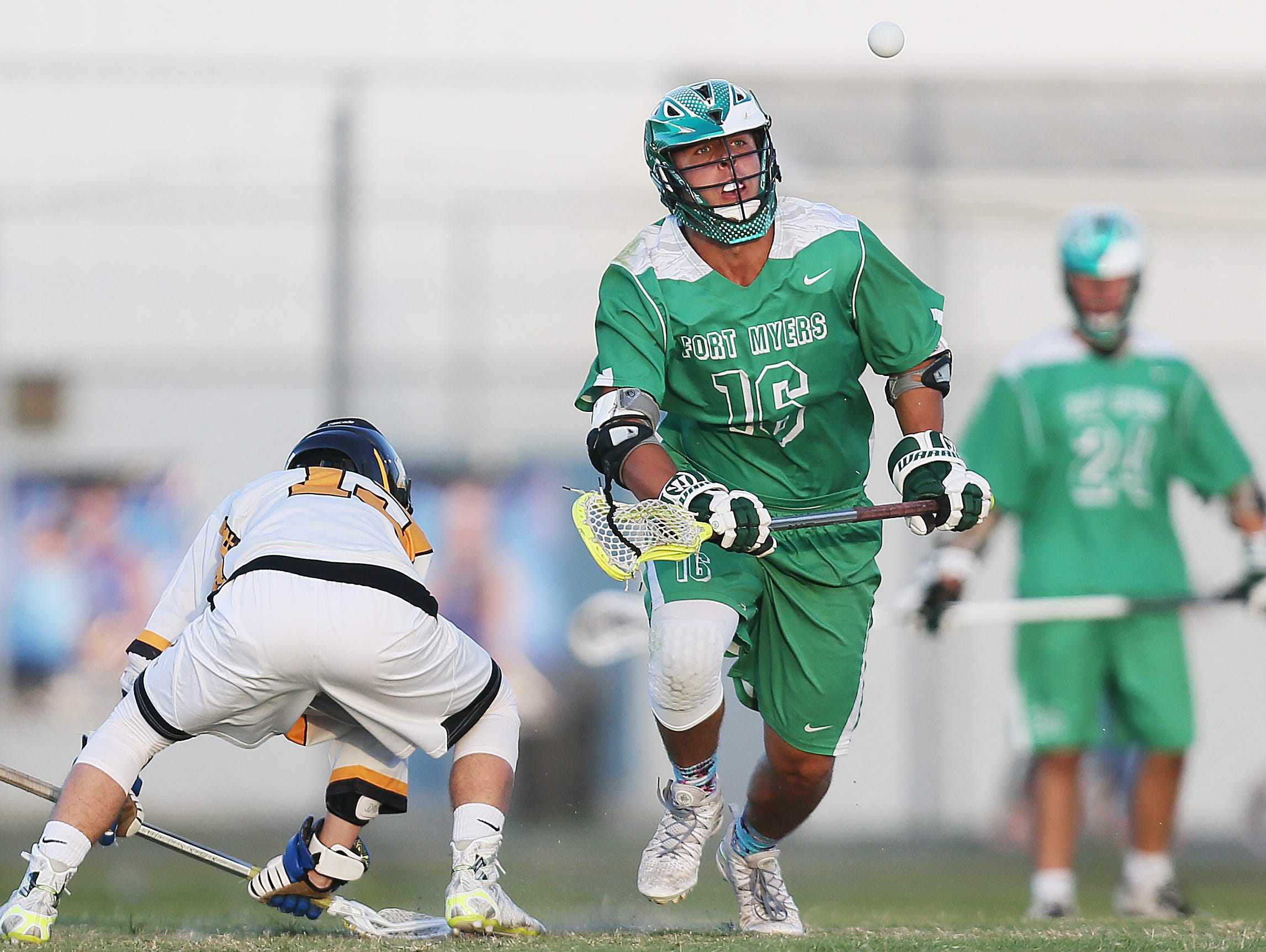 Fort Myers High School's Max Adams, center, tracks a pass against Bishop Verot during the District 18 lacrosse final Friday at the Canterbury School in Fort Myers. Bishop Verot beat Fort Myers 13-6.