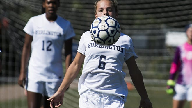 Burlington's Maggie Barlow (6) plays the ball during the girls high school soccer game between the South Burlington Rebels and the Burlington Seahorses at Buck Hard Field on Saturday morning.