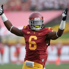 Oct 26, 2013; Los Angeles, CA, USA; USC Trojans safety Josh Shaw (6) tries to get the crowd going during the third quarter of the Trojans 19-3 win over the Utah Utes at Los Angeles Memorial Coliseum. Mandatory Credit: Robert Hanashiro-USA TODAY Sports