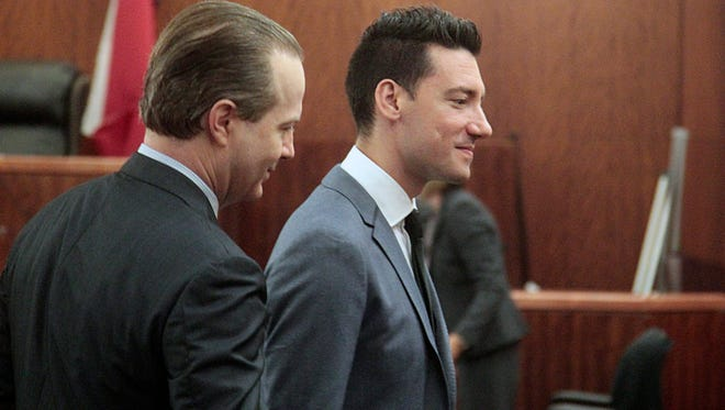 David Daleiden, right, along with one of his lawyers, Jared Woodfill, exit the 338th State District Court room on July 26, 2016, in Houston. A Texas judge dismissed the last remaining charge against two California anti-abortion activists who made undercover videos of themselves trying to buy fetal tissue from Planned Parenthood.