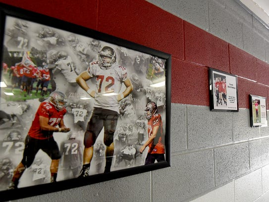 Plaques and photos of Bryce Lutz decorate one of the