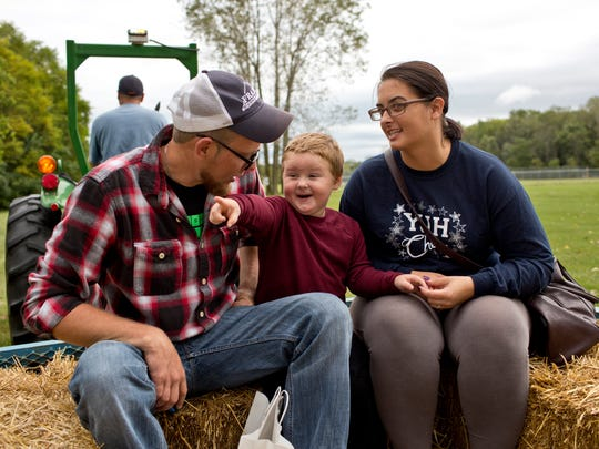 Gavin Witt, 3, rides on a hayride with his mom and dad Mackenzie and Dan Witt, of Port Huron Township, during the Port Huron Township Fall Festival Saturday, September 19, 2015 at Memorial Park.
