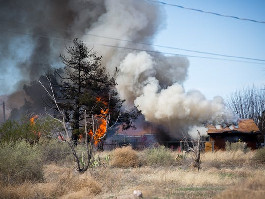 A home burns off of Old Picacho Road near Shalem Colony Trail.