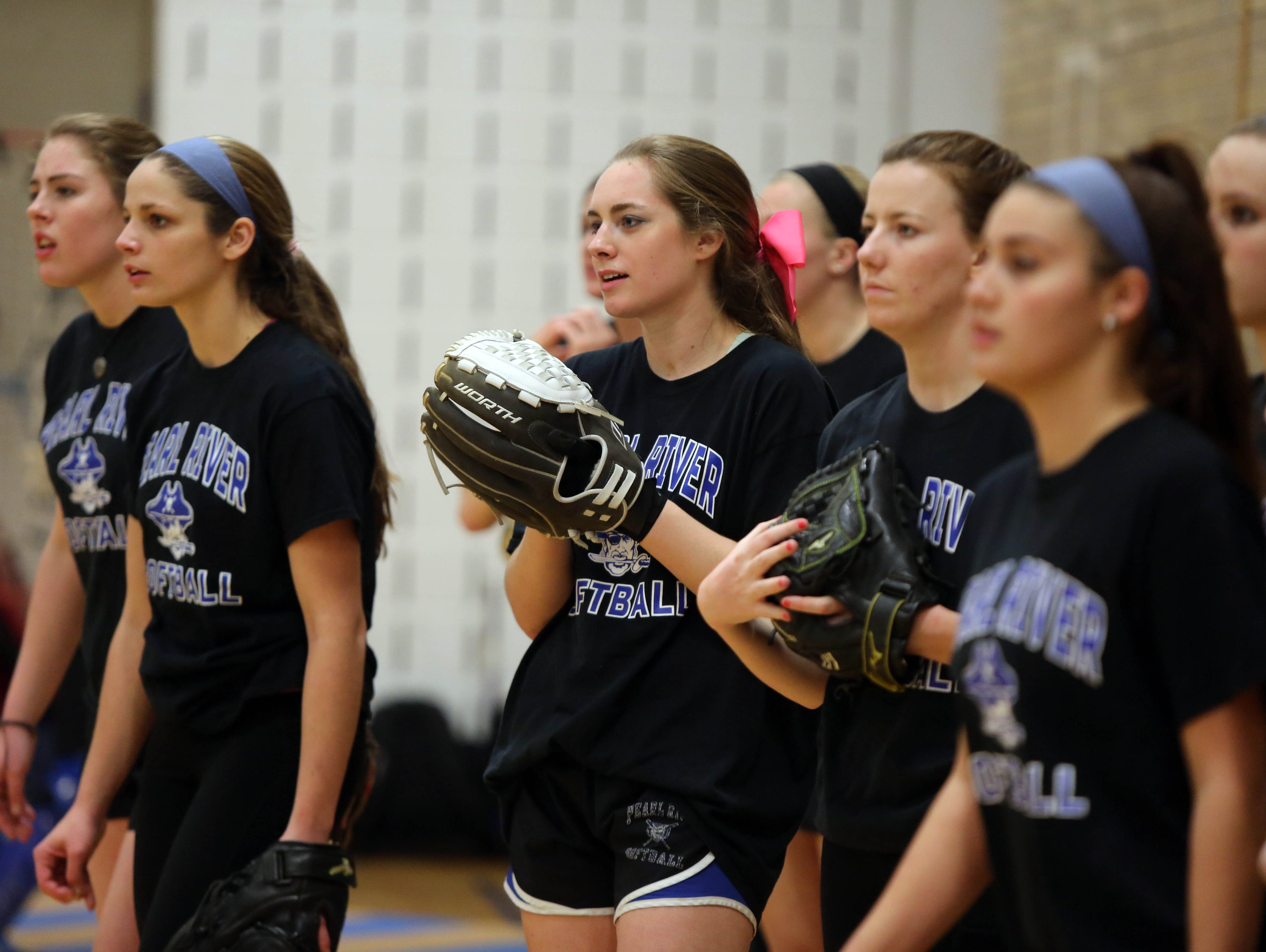Pearl Rivers girls softball team practices in the gym at the high school on March 14, 2016.