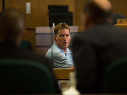 Ross Flynn glances at defendant Richard Garcia on Monday,