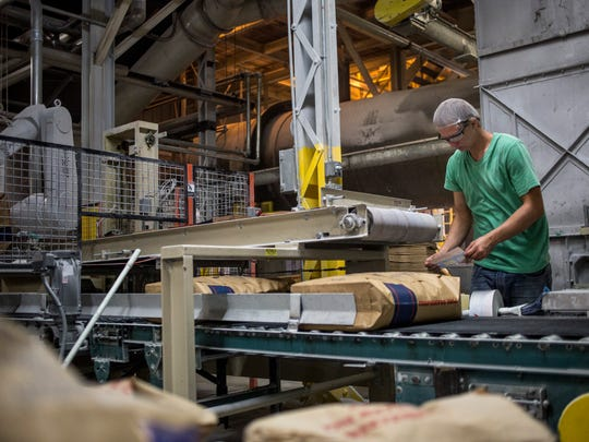 Bags of sugar are inspected and labeled in August 2016 at the Michigan Sugar plant in Croswell.