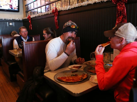 Steven Fuerst and Paula Durkin of, Pleastantville, eat pizza at Colony Grill in Stamford.