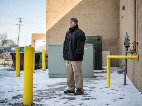 """Stacy Tunich, a detective with the St. Clair County Sheriff's Department, pictured near the area behind Kroger in Port Huron Township where Delmas """"Duane"""" Hunley, 53, of Port Huron, was found dead in August 2014."""
