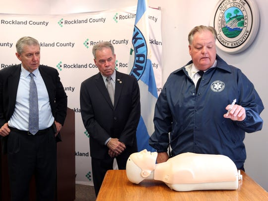 Michael Murphy, chief of operations for the Rockland Paramedic Services, demonstrates how to administer narcan, an opioid antagonist, as District Attorney Thomas Zugibe, left, and County Exective Ed Day look on April 24, 2017 in New City.