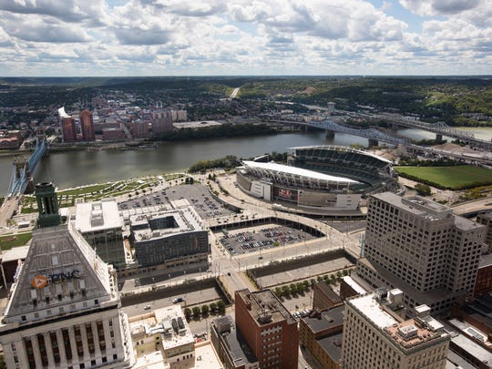 A view of Cincinnati looking south toward Kentucky. Photographed from the Carew Tower. The Ohio river separates Cincinnati from Kentucky. The Brent Spence Bridge is on the far right. At left is the John A. Roebling Suspension Bridge.