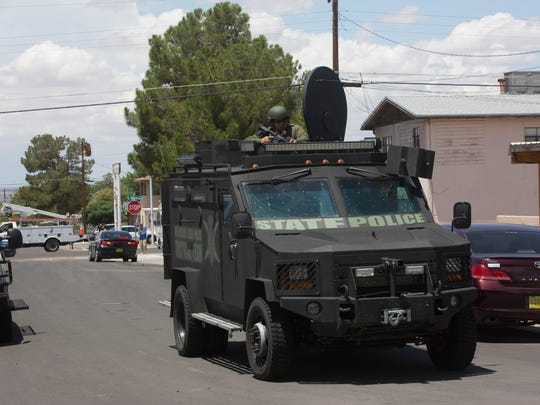The New Mexico State Police tactical team moves to the scene of a person who was barricaded in a vehicle on July 17, 2017.