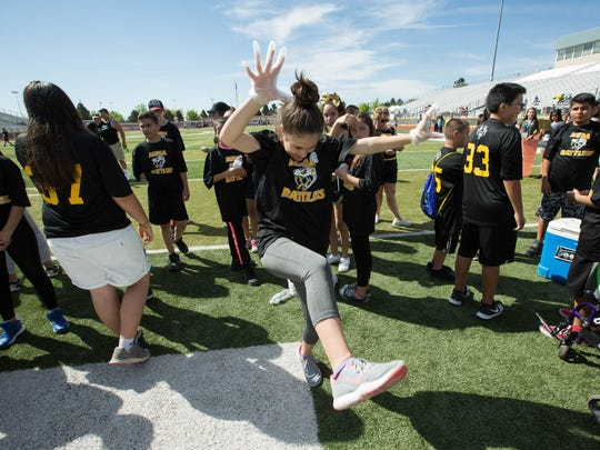 Hana Lucero, an eighth-grade student at Mesa Middle School, dances between track events at an inclusive track meet at the Field of Dreams Thursday April 5, 2018.