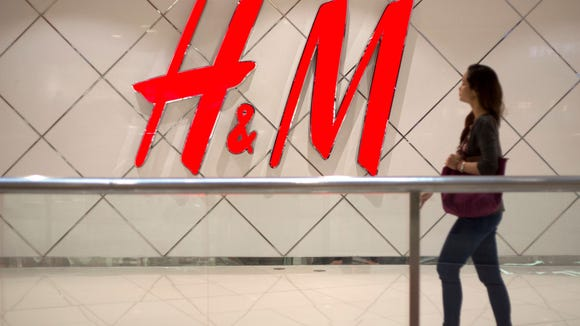 """H&M has said it's sorry for an online ad with a young black model wearing a hoodie which said """"coolest monkey in the jungle"""" on it. Credit: RITCHIE B. TONGO, EPA-EFE"""